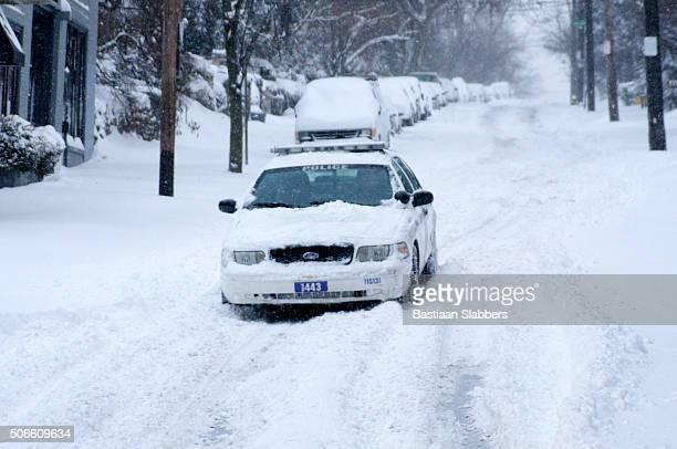 record-breaking snowfall hits u.s. east coast - philadelphia police car stock pictures, royalty-free photos & images