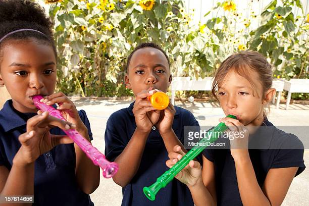 recorder playing - recorder musical instrument stock photos and pictures