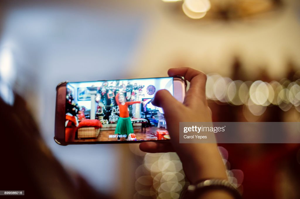 recording a video in christmas time : Stock Photo