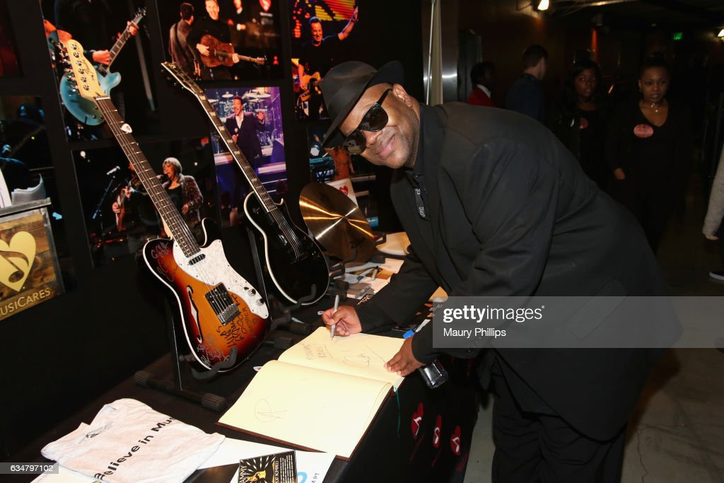 Recording Academy Chair Emeritus Jimmy Jam poses with the charities signings during the 59th GRAMMY Awards at STAPLES Center on February 11, 2017 in Los Angeles, California.
