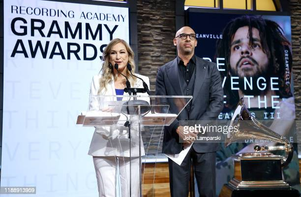 Recording Academy president and CEO Deborah Dugan and Chair of the Board of Trustees of the Recording Academy Harvey Mason Jr present Best Pop Solo...