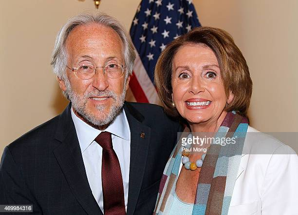 Recording Academy President and CEO Neil Portnow poses for a photo with House Minority Leader Nancy Pelosi during a discussion on the advancement of...