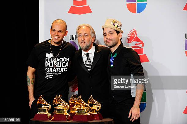 Recording Academy President/CEO Neil Portnow poses with musicians Eduardo Cabra Martinez and Rene Perez Joglar of the musical group Calle 13 pose in...