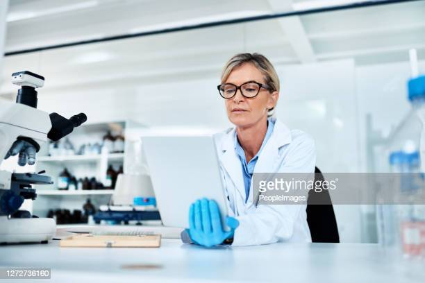 recording and analysing data at hand - forensicpathologist stock pictures, royalty-free photos & images