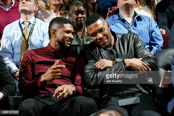 Recording Arist Usher and Former New York Giant Michael Strahan attend a game between the New York Knicks and Cleveland Cavaliers on October 30 2014...