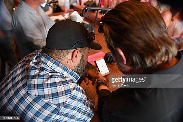 Recording Artist Aaron Lewis checks album performance during a visit to SiriusXM's Music Row Happy Hour hosted by Buzz Brainard on SiriusXM's The...