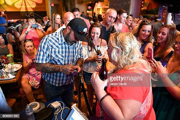 Recording Artist Aaron Lewis greets fans during a visit SiriusXM's Music Row Happy Hour hosted by Buzz Brainard on SiriusXM's The Highway at...