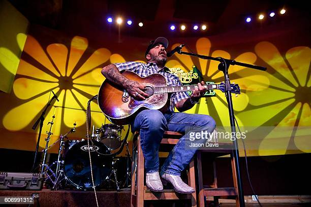 Recording Artist Aaron Lewis performs on stage during a visit to SiriusXM's Music Row Happy Hour hosted by Buzz Brainard on SiriusXM's The Highway at...