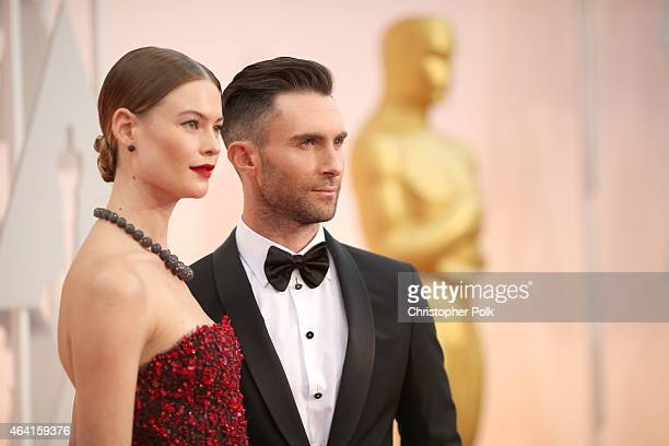 Recording artist Adam Levine and Behati Prinsloo attend the 87th Annual Academy Awards at Hollywood Highland Center on February 22 2015 in Hollywood...