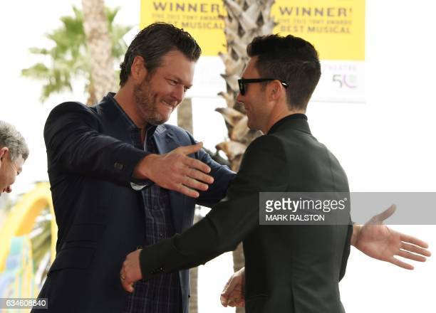 Recording artist Adam Levine and singer Blake Shelton hug before Levine was honored with a Star on the Hollywood Walk of Fame in Hollywood California...