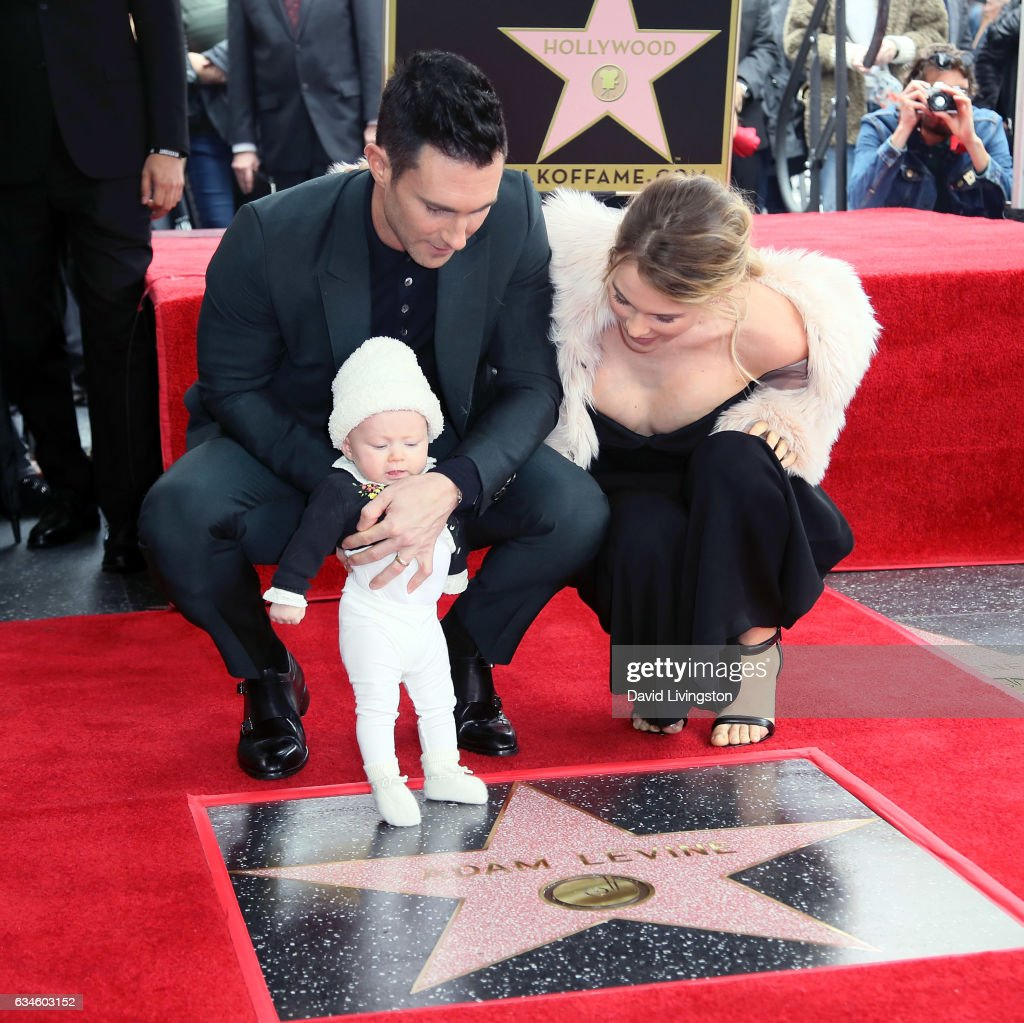 Recording artist Adam Levine (L), wife model Behati Prinsloo and their daughter attend his being honored with a Star on the Hollywood Walk of Fame on February 10, 2017 in Hollywood, California.