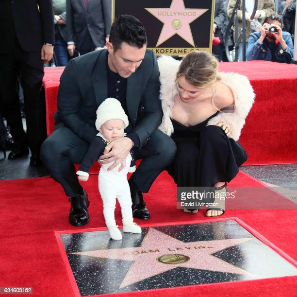 Recording artist Adam Levine wife model Behati Prinsloo and their daughter attend his being honored with a Star on the Hollywood Walk of Fame on...