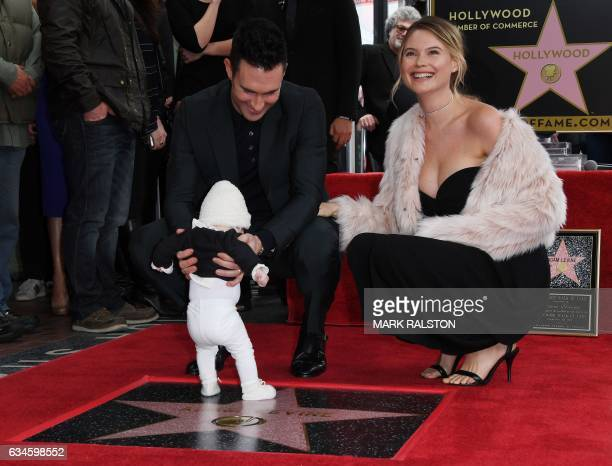 Recording artist Adam Levine with wife model Behati Prinsloo and daughter Dusty Rose pose after he was honored with a Star on the Hollywood Walk of...