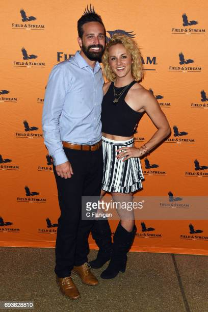 Recording artist Adley Stump and Blake Kinsman pose at Jason Aldean and the Country Music Hall of Fame and Museum surprise fans with a free concert...