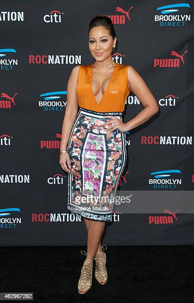 Recording artist Adrienne Bailon arrives at the Roc Nation PreGRAMMY Brunch on February 7 2015 in Beverly Hills California