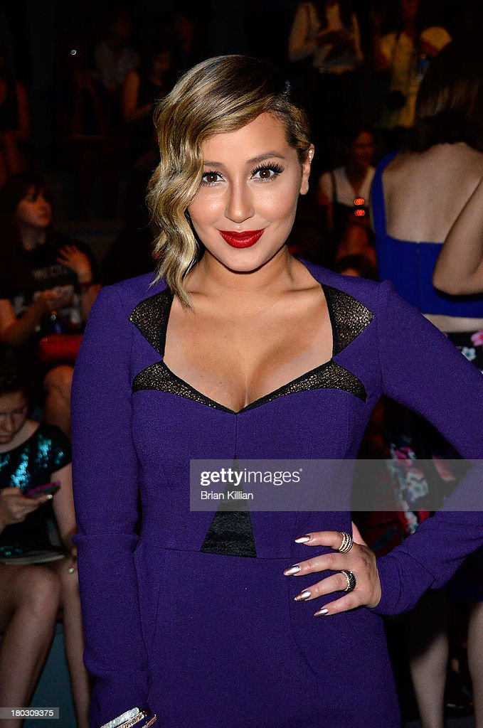 Recording artist Adrienne Bailon attends the Nanette Lepore show during Spring 2014 Mercedes-Benz Fashion Week at The Stage at Lincoln Center on September 11, 2013 in New York City.