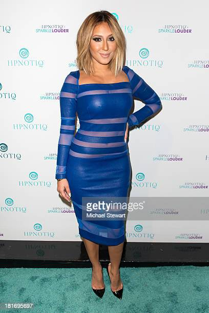 Recording Artist Adrienne Bailon attends the Sparkle Louder program launch on September 23 2013 in New York City