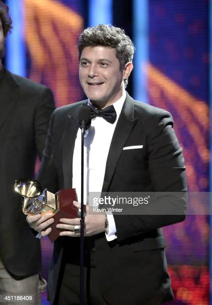 Recording artist Alejandro Sanz accepts the award for Best Contemporary Pop Vocal Album for 'La Musica No Se Toca' onstage during The 14th Annual...