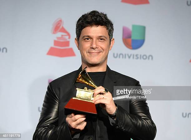 Recording artist Alejandro Sanz winner of the Best Contemporary Pop Vocal Album for 'La Música No Se Toca' poses in the press room at the 14th Annual...
