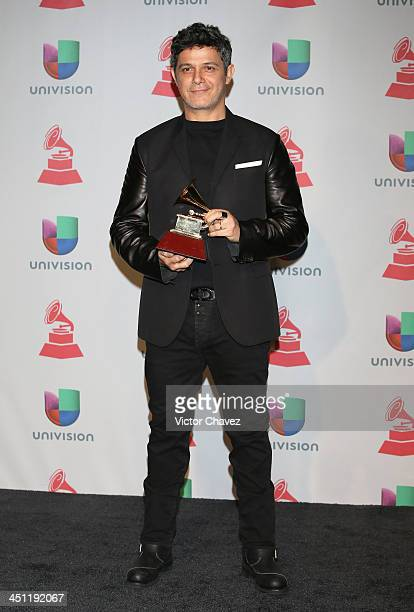 Recording artist Alejandro Sanz winner of the Best Contemporary Pop Vocal Album for 'La Música No Se Toca' poses in the press room during The 14th...