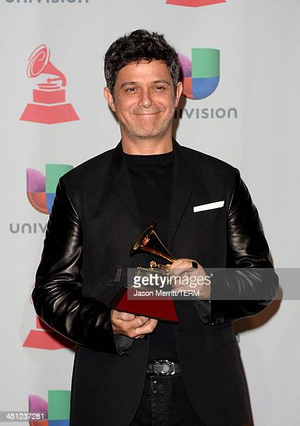 Recording artist Alejandro Sanz winner of the Best Contemporary Pop Vocal Album for 'La Música No Se Toca poses in the press room at the 14th Annual...