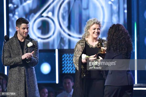 Recording artist Alessia Cara accepts the award for Best New Artist from Nick Jonas and Kelly Clarkson onstage during the 60th Annual GRAMMY Awards...