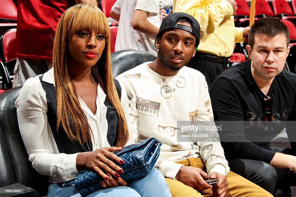 Recording artist Alexandra Burke, left, attends a game between the Washington Wizards and Miami Heat on January 6, 2013 at American Airlines Arena in Miami, Florida.