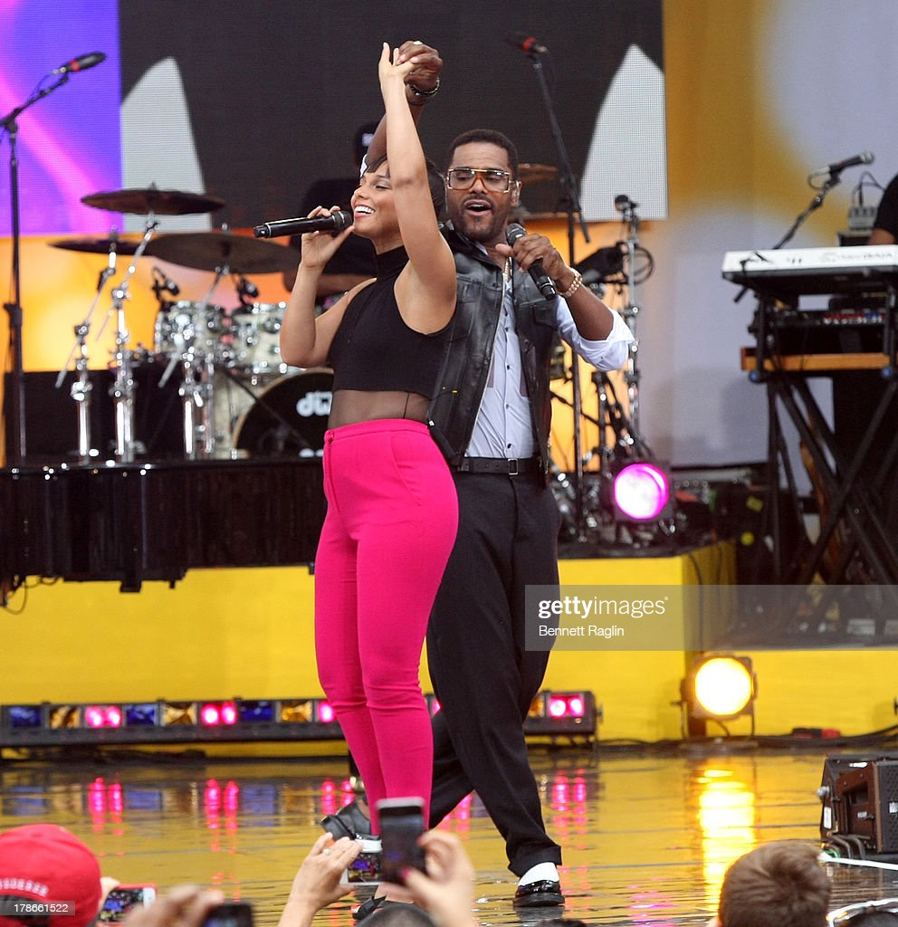 Recording artist Alicia Keys and Maxwell perform on ABC's 'Good Morning America' at Rumsey Playfield on August 30, 2013 in New York City.