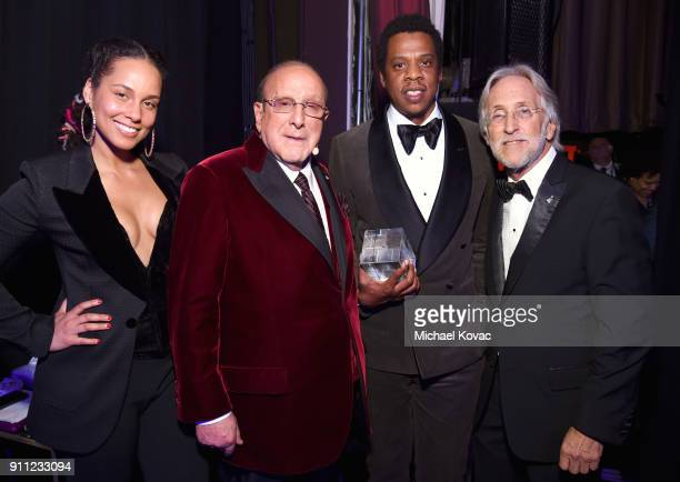 Recording artist Alicia Keys host Clive Davis Honoree JayZ and Recording Academy and MusiCares President/CEO Neil Portnow attend the Clive Davis and...