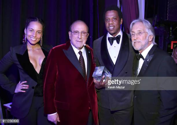Recording artist Alicia Keys host Clive Davis honoree JayZ and The Recording Academy and MusiCares President/CEO Neil Portnow attend the Clive Davis...