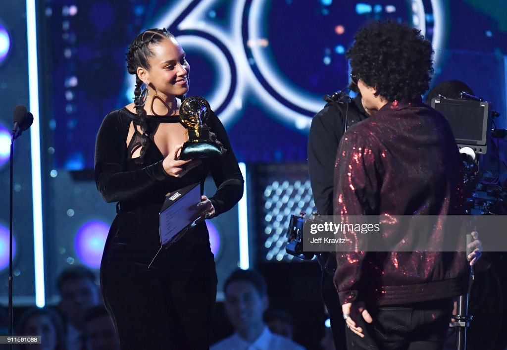 Recording artist Alicia Keys (L) presents the award for Record of the Year to recording artist Bruno Mars onstage during the 60th Annual GRAMMY Awards at Madison Square Garden on January 28, 2018 in New York City.