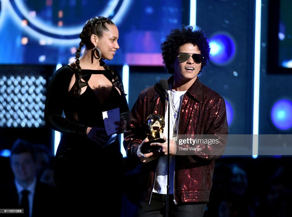 Recording artist Alicia Keys (L) presents the Record Of The Year award to recording artist Bruno Mars for '24K Magic' onstage during the 60th Annual GRAMMY Awards at Madison Square Garden on January 28, 2018 in New York City.