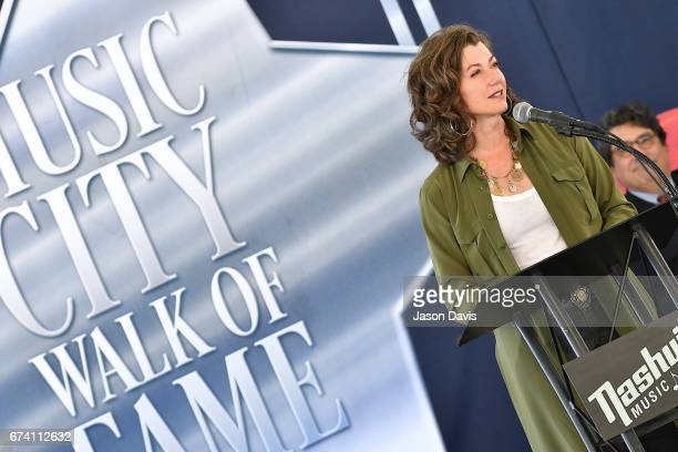Recording artist Amy Grant speaks during the induction ceremony of Amy Grant and Martha R Ingram at Walk of Fame Park on April 27 2017 in Nashville...