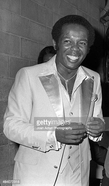 Recording artist and actor Lou Rawls backstage during a tribute to Muhammad Ali celebration at the Forum on September 6, 1979 in Los Angeles,...