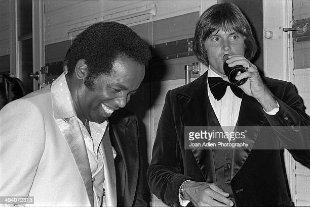 Recording artist and actor Lou Rawls with athlete and TV personality Bruce Jenner backstage during a tribute to Muhammad Ali celebration at the Forum...