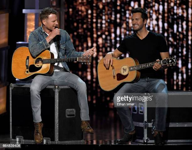 Recording artist and cohost Dierks Bentley speaks next to a wax figure of cohost Luke Bryan during the 52nd Academy of Country Music Awards at...