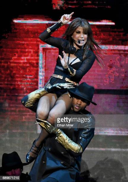Recording artist and dancer Paula Abdul is carried by a dancer as she performs during a stop of The Total Package Tour at TMobile Arena on May 28...