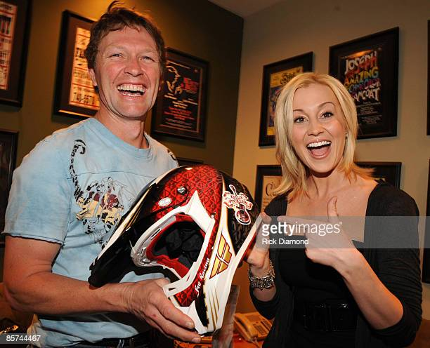 COVERAGE*** Recording artist and host Craig Morgan presents recording artist Kelly Pickler with a helmet backstage at the Craig Morgan Charity Event...