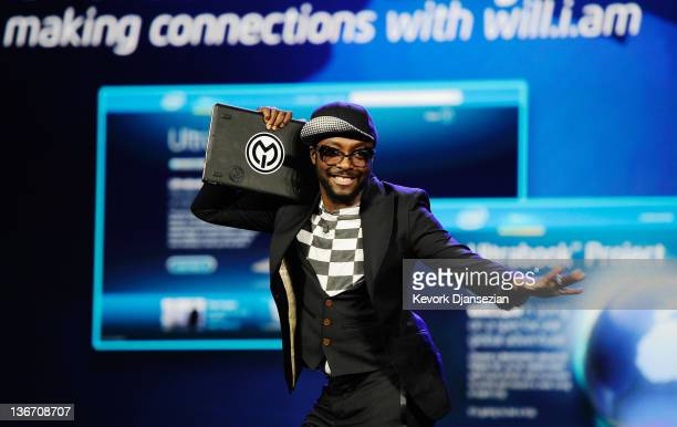 Recording artist and Intel's director of creative innovation william holds his Intel Ultrabook device during Intel's presentation at the 2012...