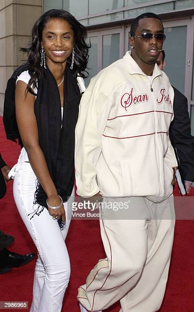 Recording artist and producer Sean 'P Diddy' Combs with his girlfriend Kim Porter attend the 2004 NBA AllStar Game held on February 15 2004 at the...