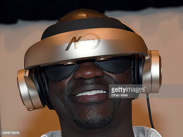 Recording artist and Royole Chief Creative Officer Akon wears a Royole Moon 3D virtual mobile theater during a press event for CES 2017 at the...