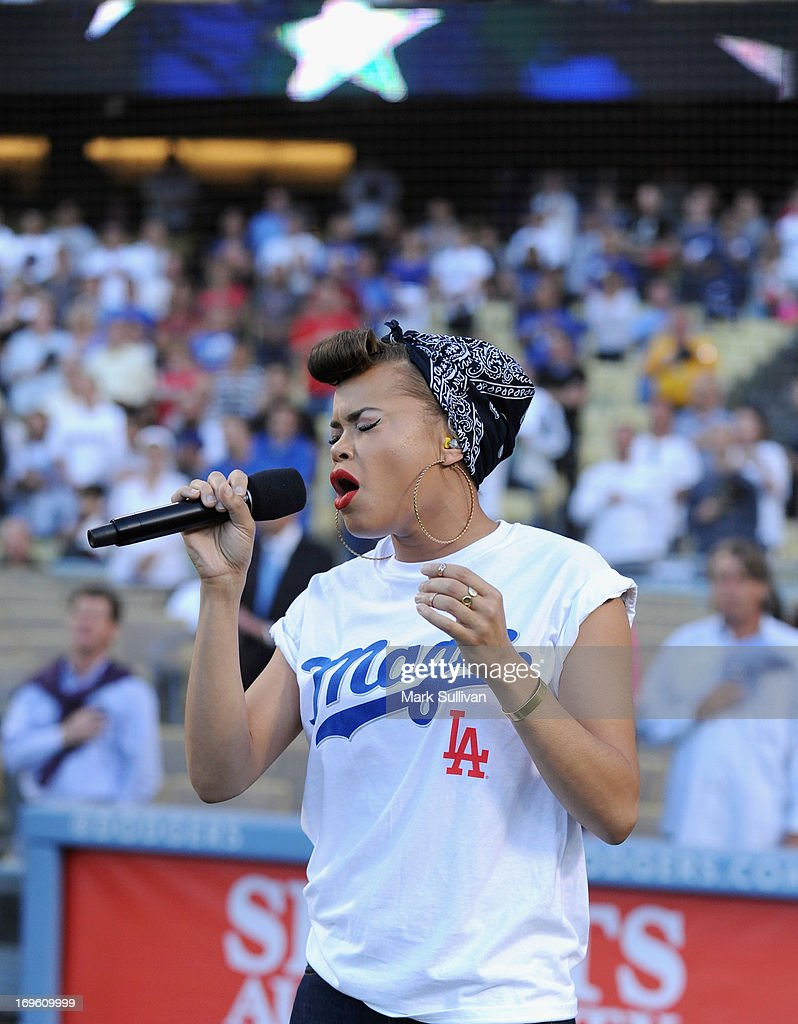 Recording Artist Andra Day sings the national anthem before the game between the Los Angeles Dodgers and the Los Angeles Angels of Anaheim at Dodger Stadium on May 28, 2013 in Los Angeles, California.