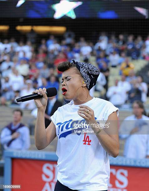Recording Artist Andra Day sings the national anthem before the game between the Los Angeles Dodgers and the Los Angeles Angels of Anaheim at Dodger...