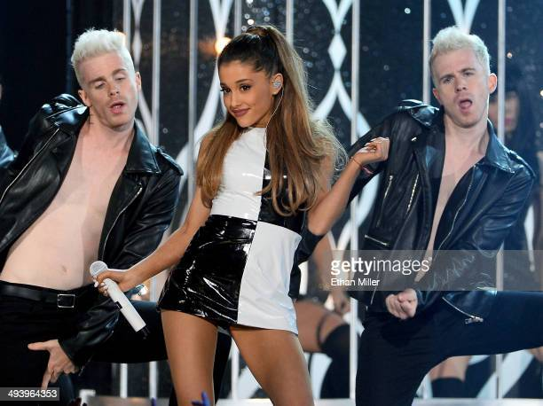 Recording artist Ariana Grande performs with dancers during the 2014 Billboard Music Awards at the MGM Grand Garden Arena on May 18 2014 in Las Vegas...