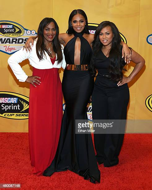 Recording artist Ashanti her mother and manager Tina Douglas and her sister Shia Douglas arrive at the 2014 NASCAR Sprint Cup Series Awards at Wynn...