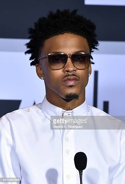 Recording artist August Alsina winner of the CocaCola Viewers' Choice Award and the Best New Artist Award poses in the Winners Room during the BET...