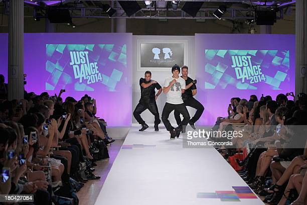 Recording artist Austin Mahone performs on the runway during Just Dance with Boy Meets Girl show at the STYLE360 Fashion Pavilion in Chelsea on...