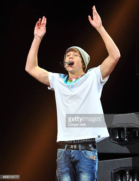 Recording artist Austin Mahone performs onstage during 1061 KISS FM's Jingle Ball 2013 at American Airlines Center on December 2 2013 in Dallas Texas