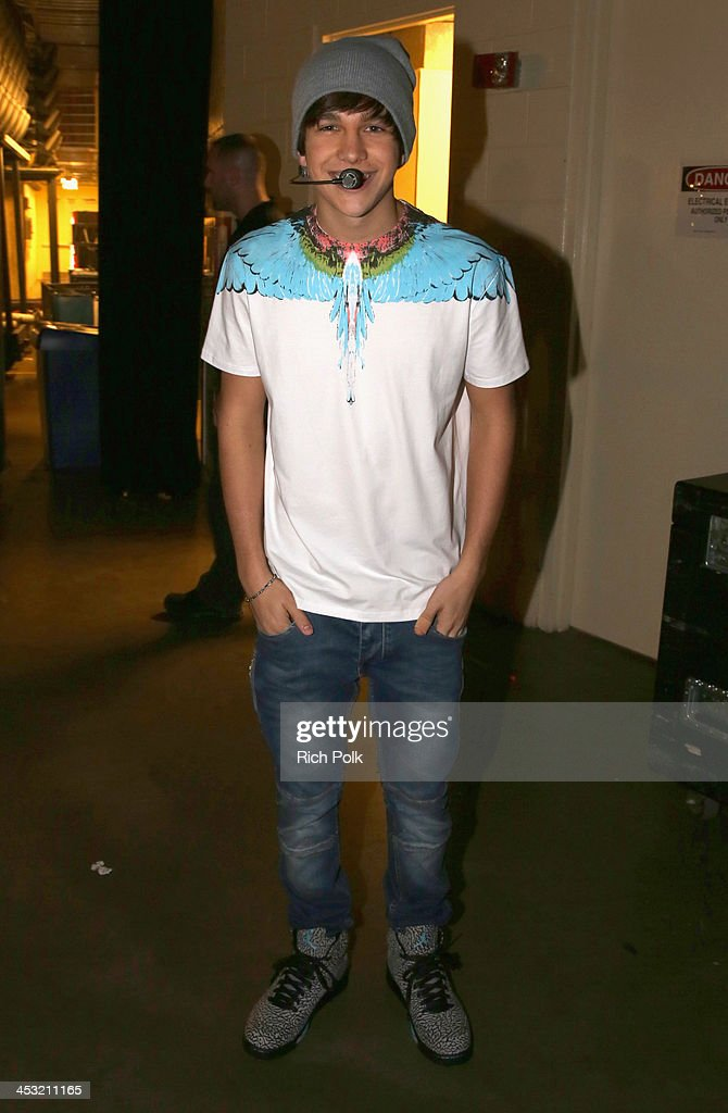 Recording artist Austin Mahone poses backstage at 106.1 KISS FM's Jingle Ball 2013 American Airlines Center at on December 2, 2013 in Dallas, Texas.