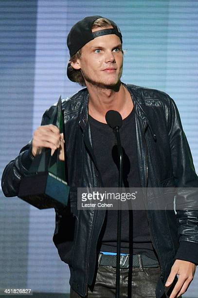 Recording artist Avicii accepts the Favorite Electronic Dance Music Artist award onstage during the 2013 American Music Awards at Nokia Theatre LA...